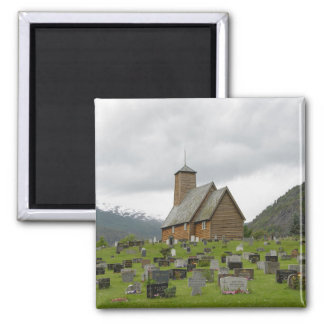 Square magnet stave church with graves in Norway