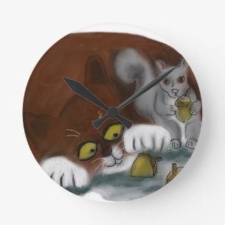 Squirrel and Cat share acorns Round Wall Clock