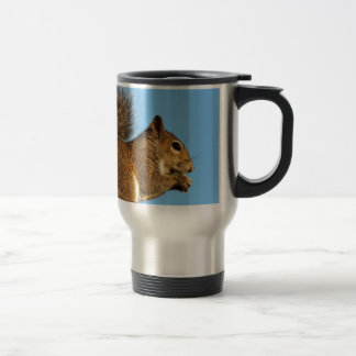 Squirrel Eating in a Tree Against Clear Blue Sky Travel Mug