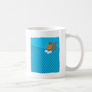 Squirrel eating pretzel coffee mug