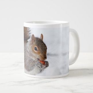 Squirrel in the snow large coffee mug