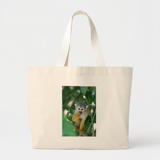 Squirrel monkey tote bags