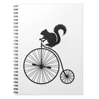 squirrel on vintage bicycle spiral notebook