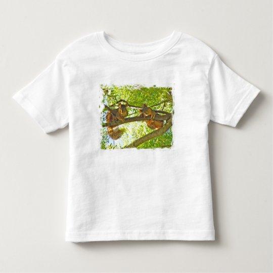 Squirrels watching child's t-shirt