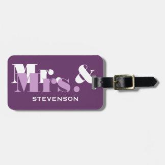 Sr y la señora púrpuras equipaje del viaje marcan