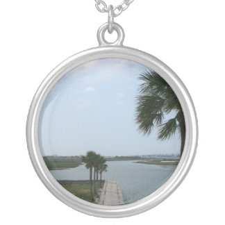 St augustine view on fort towards inlet round pendant necklace