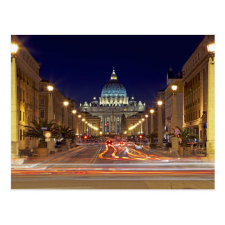 St Peter's Basilica toward end of road at night Postcard