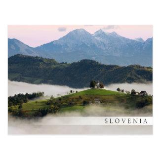 St. Thomas church with mountains in Slovenia bar Postcard