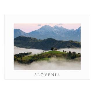 St. Thomas church with mountains in Slovenia white Postcard