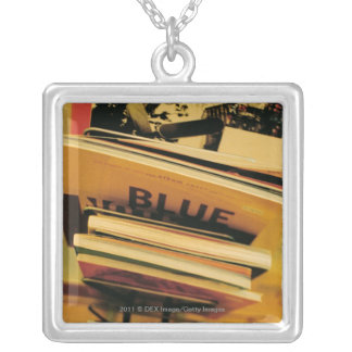 Stack of books and magazines square pendant necklace