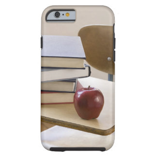 Stack of books, , and school desk tough iPhone 6 case