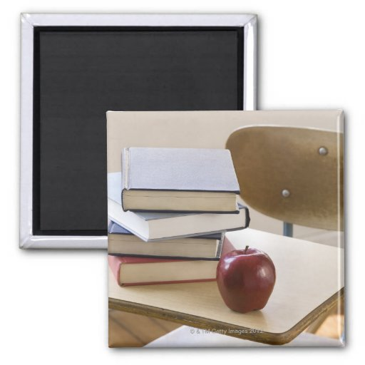 Stack of books, apple, and school desk refrigerator magnets