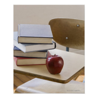 Stack of books, apple, and school desk poster