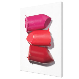 Stack of broken lipstick stretched canvas print