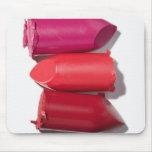 Stack of broken lipstick mouse pad