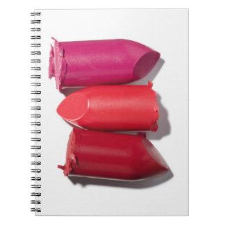 Stack of broken lipstick notebook