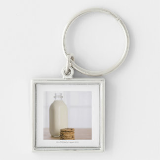 Stack of chocolate chip cookies milk in a glass keychain