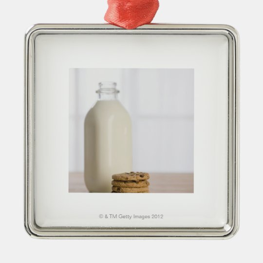 Stack of chocolate chip cookies milk in a glass metal ornament