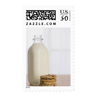 Stack of chocolate chip cookies milk in a glass postage