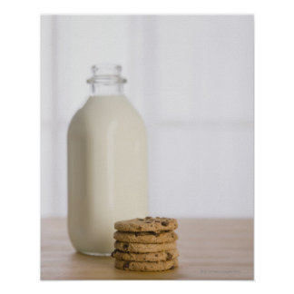 Stack of chocolate chip cookies milk in a glass poster