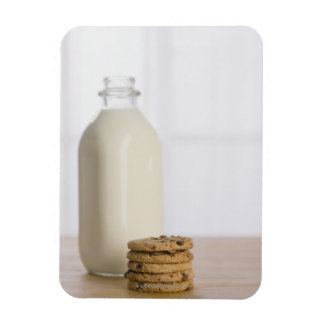 Stack of chocolate chip cookies milk in a glass rectangular photo magnet