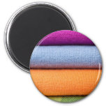 Stack of colorful cotton cloth fridge magnets