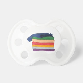 Stack of colorful towels BooginHead pacifier