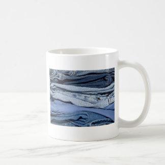 stack of denim jeans coffee mug