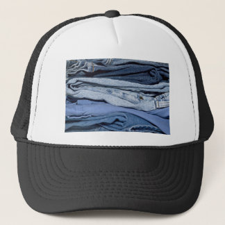 stack of denim jeans trucker hat