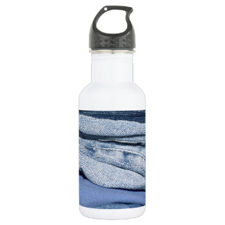stack of denim jeans water bottle
