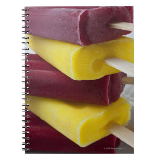 Stack of frozen ice pops, ice cream on a stick notebook