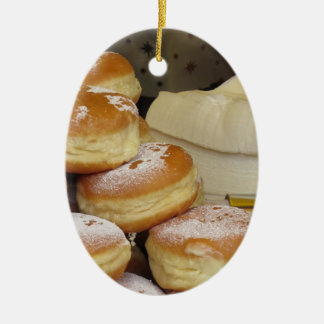 Stack of italian doughnuts with icing sugar Double-Sided oval ceramic christmas ornament