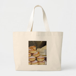 Stack of italian doughnuts with icing sugar large tote bag
