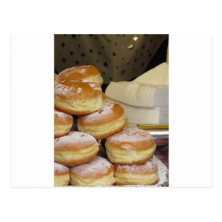 Stack of italian doughnuts with icing sugar postcard