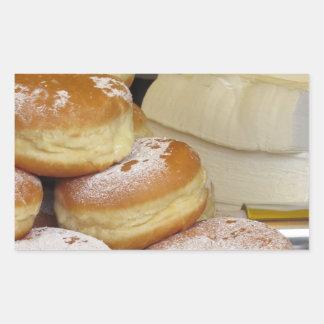 Stack of italian doughnuts with icing sugar rectangular sticker