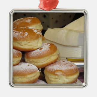 Stack of italian doughnuts with icing sugar square metal christmas ornament