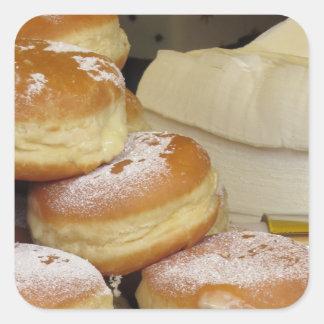 Stack of italian doughnuts with icing sugar square sticker