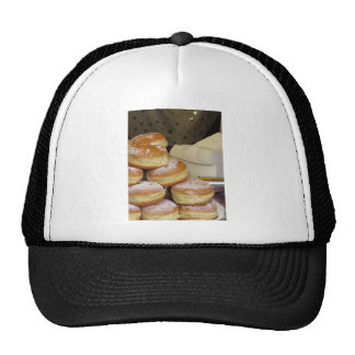 Stack of italian doughnuts with icing sugar trucker hat