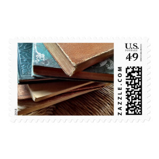 stack of old books postage stamp