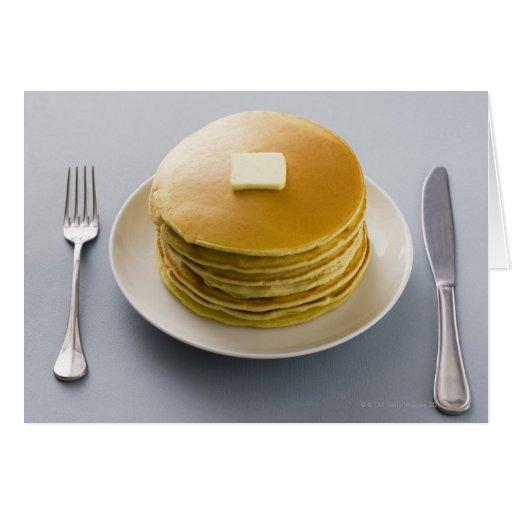 Stack of pancakes with butter on a plate cards