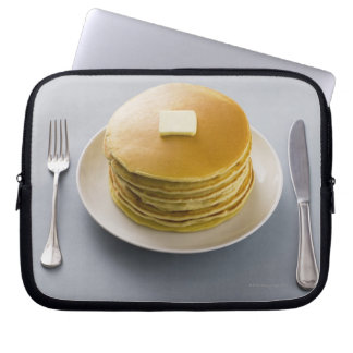 Stack of pancakes with butter on a plate computer sleeve