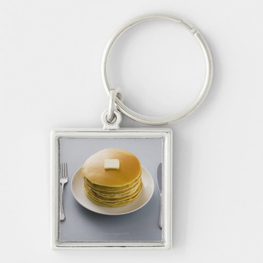 Stack of pancakes with butter on a plate key chain