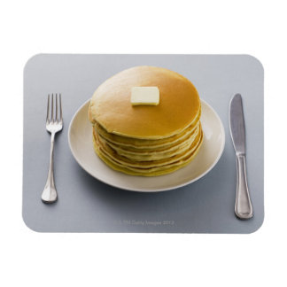Stack of pancakes with butter on a plate magnet