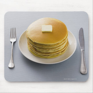 Stack of pancakes with butter on a plate mouse pad
