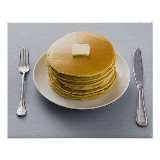 Stack of pancakes with butter on a plate poster