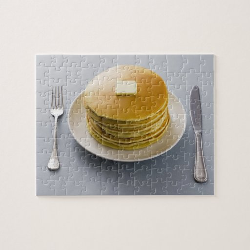 Stack of pancakes with butter on a plate puzzle