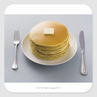 Stack of pancakes with butter on a plate stickers