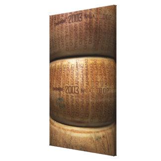 Stack of parmesan cheeses, close-up canvas print