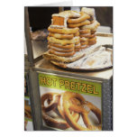 Stack of pretzels at a stall greeting card