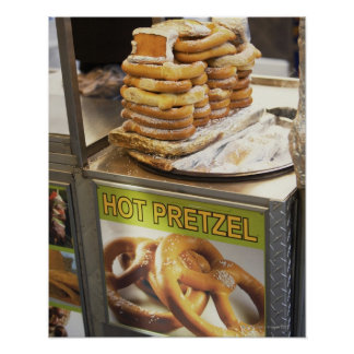 Stack of pretzels at a stall poster